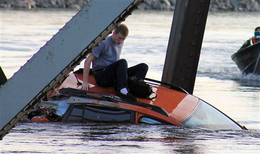 "<div class=""meta ""><span class=""caption-text "">In this photo provided by Francisco Rodriguez, a man is seen sitting atop a car that fell into the Skagit River after the collapse of the Interstate 5 bridge there minutes earlier Thursday, May 23, 2013, in Mount Vernon, Wash. (AP Photo/Francisco Rodriguez) (AP Photo/ Francisco Rodriguez)</span></div>"