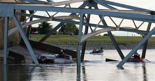 In this photo provided by Francisco Rodriguez, a rescue boat approaches the scene where a pickup truck and a car fell into the Skagit River after the collapse of the Interstate 5 bridgeThursday, May 23, 2013, in Mount Vernon, Wash. &#40;AP Photo&#47;Francisco Rodriguez&#41; <span class=meta>(AP Photo&#47; Francisco Rodriguez)</span>