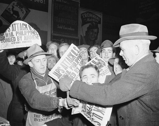 Selling papers  on Dec. 7, 1941 at Times Square in New York City, announcing that Japan has attacked U.S. bases in the Pacific. <span class=meta>(AP Photo&#47; Robert Kradin)</span>