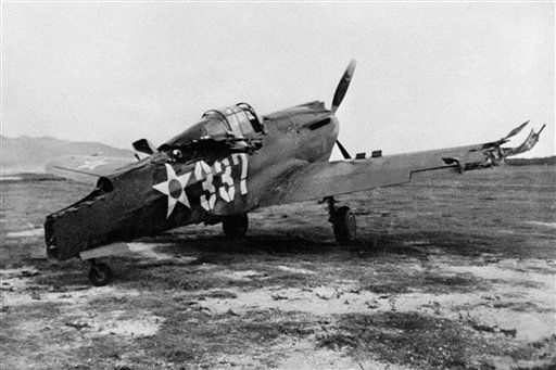 This is one of the first pictures of the Japanese raid on Pearl Harbor, Dec. 7, 1941. A P-40 plane which was machine-gunned while on the ground.  <span class=meta>(AP Photo&#47; XJFM)</span>