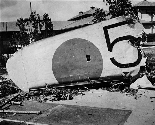 "<div class=""meta ""><span class=""caption-text "">The wing of a Japanese bomber shot down on the grounds of the Naval Hospital at Honolulu, Hawaii, Dec. 7, 1941. (AP Photo/ XJFM)</span></div>"