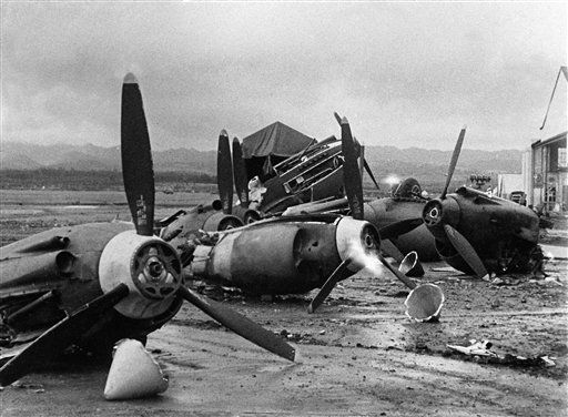 The shattered wreckage of American planes bombed by the Japanese in their attack on Pearl Harbor is strewn on Hickam Field, Dec. 7, 1941. <span class=meta>(AP Photo&#47; XJFM)</span>