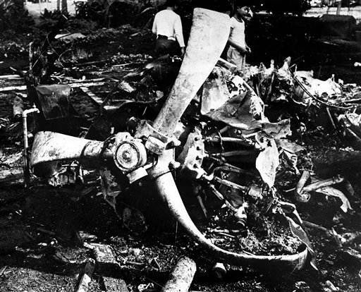"<div class=""meta ""><span class=""caption-text "">Youths inspect the wreckage of a Japanese bomber, Dec. 17, 1941 brought down by a United States P-40 plane during the Dec 7, 1941 attack on Oahu, Hawaii.  (AP Photo/ XJFM)</span></div>"