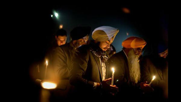Varinder Singh, of the Queens borough of New York, joins a group of Sikhs from around the Northeastern U.S., in a moment of prayer as a memorial service is broadcast over a loudspeaker outside Newtown High School for the victims of the Sandy Hook Elementary School shooting, Sunday, Dec. 16, 2012, in Newtown, Conn. <span class=meta>(AP Photo&#47;David Goldman)</span>
