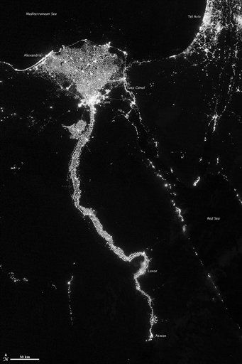 In this image from Oct. 13, 2012 provided by NASA, the Nile River valley and delta is seen at night from a composite assembled from data acquired by the Suomi NPP satellite. The image was made possible by the new satellite&#39;s &#34;day-night band&#34; of the Visible Infrared Imaging Radiometer Suite &#40;VIIRS&#41;, which detects light in a range of wavelengths from green to near-infrared and uses filtering techniques to observe dim signals such as city lights, gas flares, auroras, wildfires, and reflected moonlight. The Nile River Valley and Delta comprise less than 5 percent of Egypt&#39;s land area, but provide a home to roughly 97 percent of the country&#39;s population. Nothing makes the location of human population clearer than the lights illuminating the valley and delta at night. The city lights resemble a giant calla lily, just one with a kink in its stem near the city of Luxor. Some of the brightest lights occur around Cairo, but lights are abundant along the length of the river. Bright city lights also occur along the Suez Canal and around Tel Aviv. Away from the lights, however, land and water appear uniformly black. This image was acquired near the time of the new Moon, and little moonlight was available to brighten land and water surfaces.  <span class=meta>(AP Photo&#47; NASA)</span>