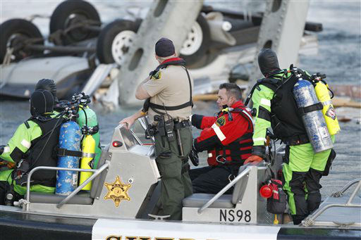 A rescue boat and divers search near a portion of the Interstate-5 bridge that is submerged after it collapsed into the Skagit river dumping vehicles and people into the water in Mount Vernon, Wash., Thursday, May 23, 2013 according to the Washington State Patrol. &#40;AP Photo&#47;Joe Nicholson&#41; <span class=meta>(AP Photo&#47; Joe Nicholson)</span>