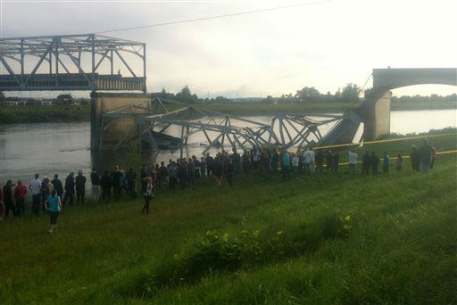 "<div class=""meta ""><span class=""caption-text "">In this photo provided by NWCN, people look on after the Interstate 5 bridge collapsed over the Skagit River in Skagit County, Wash., Thursday, May 23, 2013. The four-lane bridge over the Skagit River collapsed about 7 p.m., Trooper Mark Francis said. There was no immediate estimate of how many people were in the water or whether there were any injuries or deaths, he said. (AP Photo/NWCN, Selina Dziura) (AP Photo/ Selina Dziura)</span></div>"