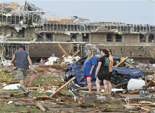 "<div class=""meta ""><span class=""caption-text "">People go through the debris near Telephone Road and SW 4th Street after a tornado moves through Moore, Okla. on Monday, May 20, 2013. (AP Photo/Alonzo Adams) (AP Photo/ Alonzo Adams)</span></div>"