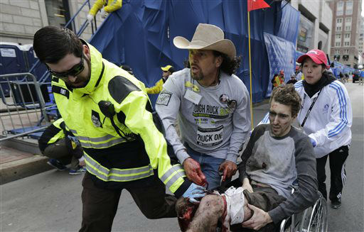 Medical responders run an injured man past the finish line the 2013 Boston Marathon following an explosion in Boston, Monday, April 15, 2013. Two explosions shattered the euphoria of the Boston Marathon finish line on Monday, sending authorities out on the course to carry off the injured while the stragglers were rerouted away from the smoking site of the blasts. &#40;AP Photo&#47;Charles Krupa&#41; <span class=meta>(AP Photo&#47; Charles Krupa)</span>