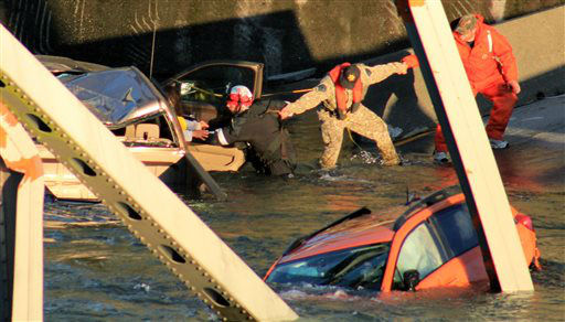 In this photo provided by Francisco Rodriguez, rescue workers form a human chain as they begin to remove a woman who reaches out from a smashed pickup truck that fell into the Skagit River after the collapse of the Interstate 5 bridgeThursday, May 23, 2013, in Mount Vernon, Wash. &#40;AP Photo&#47;Francisco Rodriguez&#41; <span class=meta>(AP Photo&#47; Francisco Rodriguez)</span>
