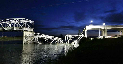 The collapsed Interstate-5 bridge is seen at dusk submerged after collapsing into the Skagit River, dumping vehicles and people into the water, in Mount Vernon, Wash., Thursday, May 23, 2013. &#40;AP Photo&#47;Elaine Thompson&#41; <span class=meta>(AP Photo&#47; Elaine Thompson)</span>