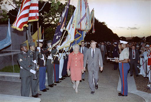 President George Bush and First Lady Barbara Bush pass a color guard as they arrive at the Punchbowl National Cemetary of the Pacific in Honolulu, Hawaii saturday morning, Dec. 7, 1991 for ceremonies commemorating the 50th anniversary of the Japanese attack on Pearl Harbor.  <span class=meta>(AP Photo&#47; RON EDMONDS)</span>