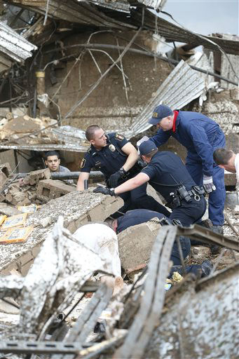"<div class=""meta ""><span class=""caption-text "">Rescue workers dig through the rubble of a collapsed wall at the Plaza Tower Elementary School to free trapped students in Moore, Okla., following a tornado Monday, May 20, 2013. (AP Photo Sue Ogrocki) (AP Photo/ Sue Ogrocki)</span></div>"