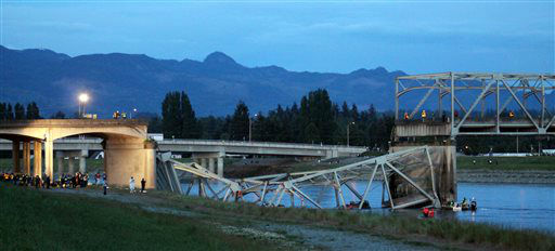 In this photo provided by Francisco Rodriguez, the scene were the Interstate 5 bridge collapsed into the Skagit River is seen at dusk Thursday, May 23, 2013, in Mount Vernon, Wash. &#40;AP Photo&#47;Francisco Rodriguez&#41; <span class=meta>(AP Photo&#47; Francisco Rodriguez)</span>