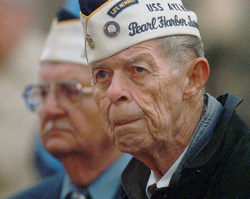 Pearl Harbor survivor Kenneth King of Yukon, Okla., listens during cermonies Thursday Dec. 7, 1995, in Oklahoma City.  King was aboard the U.S. Navy destroyer USS Aylwin when the Japanese attacked 54-years agao.  <span class=meta>(AP Photo&#47; DAVID LONGSTREATH)</span>