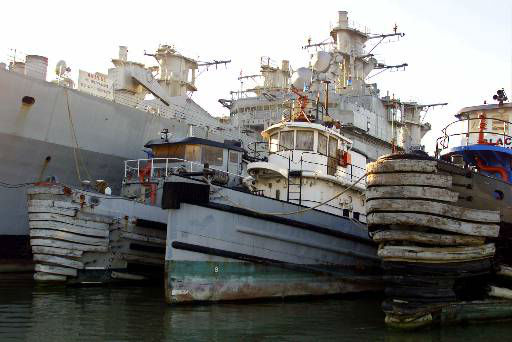 The USS Hoga, center with white wheelhouse, a 100-foot-long Navy yard tugboat which is the last surviving Navy vessel from the 1941 attack on Pearl Harbor, sits in the mothball fleet in San Francisco Bay, Calif., in this Dec. 17, 1999 photo. Built in 1940, the tug is considered inactive by the Navy, which wants to scrap it. While there is interest in saving it, there are no firm offers.  <span class=meta>(AP Photo&#47; ERIC RISBERG)</span>