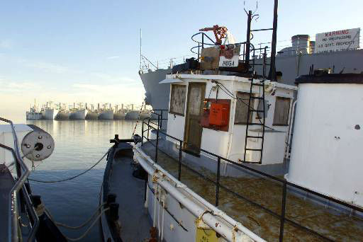 The bow of the USS Hoga, a 100-foot Navy yard tugboat which is the last surviving Navy vessel from the 1941 attack on Pearl Harbor that plunged the United States into World War II, faces a row of mothballed WWII Victory ships at the reserve fleet in San Francisco Bay, Calif., in this Dec. 17, 1999 photo. Built in 1940, the tug is considered inactive by the Navy, which wants to scrap it. While there is interest in saving it, there are no firm offers.  <span class=meta>(AP Photo&#47; ERIC RISBERG)</span>