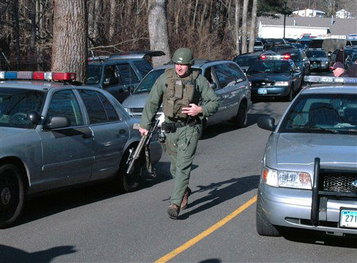 "<div class=""meta image-caption""><div class=""origin-logo origin-image ""><span></span></div><span class=""caption-text"">In this photo provided by the Newtown Bee, police officers are on the scene outside Sandy Hook Elementary School in Newtown, Conn., where authorities say a gunman opened fire, killing 26 people, including 20 children, Friday, Dec. 14, 2012.  (AP Photo/ Newtown Bee, Shannon Hicks)</span></div>"