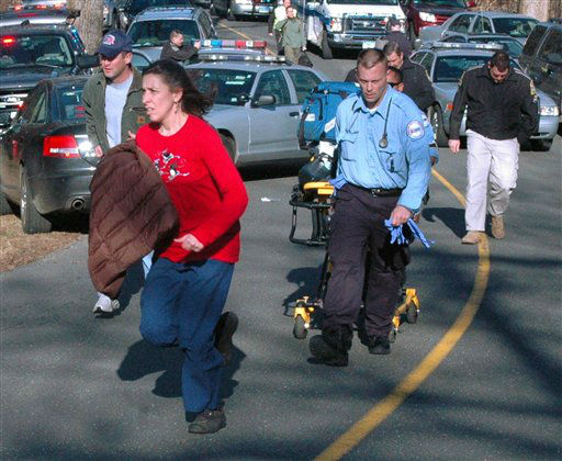 "<div class=""meta image-caption""><div class=""origin-logo origin-image ""><span></span></div><span class=""caption-text"">In this photo provided by the Newtown Bee, paramedics and others rush toward Sandy Hook Elementary School in Newtown, Conn., where authorities say a gunman opened fire, killing 26 people, including 20 children, Friday, Dec. 14, 2012.  (AP Photo/ Newtown Bee, Shannon Hicks)</span></div>"