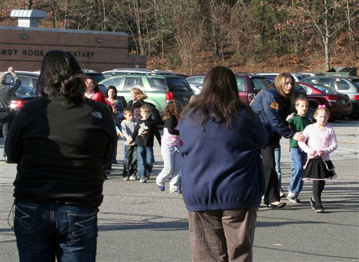 "<div class=""meta image-caption""><div class=""origin-logo origin-image ""><span></span></div><span class=""caption-text"">In this photo provided by the Newtown Bee, people look on as students are led out of Sandy Hook Elementary School in Newtown, Conn., where authorities say a gunman opened fire, killing 26 people, including 20 children, Friday, Dec. 14, 2012.  (AP Photo/ Newtown Bee, Shannon Hicks)</span></div>"