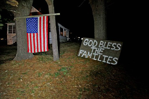 "<div class=""meta image-caption""><div class=""origin-logo origin-image ""><span></span></div><span class=""caption-text"">Across the street from the elementary school in Sandy Hook, Conn. neighbors hoisted an American flag and created a make-shift prayer for the deceased inside the school late Friday Dec. 14, 2012.  (AP Photo/ Robert Ray)</span></div>"