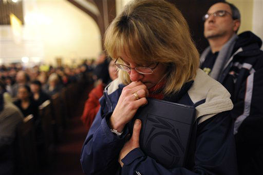 "<div class=""meta image-caption""><div class=""origin-logo origin-image ""><span></span></div><span class=""caption-text"">Mourners gather at a vigil service for victims of the Sandy Hook Elementary School shooting, at the St. Rose of Lima Roman Catholic Church in Newtown, Conn. Friday, Dec. 14, 2012.  (AP Photo/ Andrew Gombert)</span></div>"