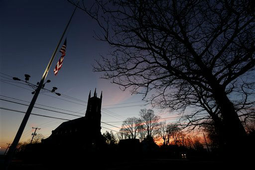 "<div class=""meta image-caption""><div class=""origin-logo origin-image ""><span></span></div><span class=""caption-text"">A U.S. flag flys at half-staff on Main Street in downtown Newtown, Conn., as the sun rises the morning after a gunman opened fire inside a nearby elementary school, Saturday, Dec. 15, 2012.  (AP Photo/ Julio Cortez)</span></div>"