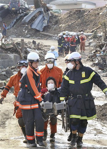 Tsunami evacuee is carried to hospital from an evacuation center in Minamisanriku, Miyagi, northern Japan Sunday, March 13, 2011 following Friday&#39;s massive earthquake and the ensuing tsunami.  <span class=meta>(AP Photo&#47; Hiroaki Ono)</span>