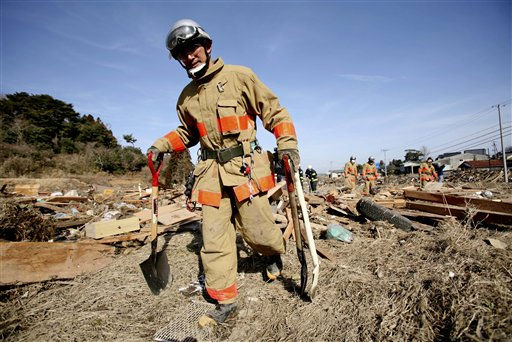 A fire department rescue worker searches for victims, Monday, March 14, 2011, in the coastal area of Soma city, Fukushima prefecture, Japan, three days after a massive earthquake and tsunami struck the country&#39;s northeast coast.  <span class=meta>(AP Photo&#47; Wally Santana)</span>