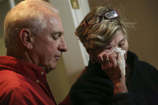 "<div class=""meta image-caption""><div class=""origin-logo origin-image ""><span></span></div><span class=""caption-text"">Ray Ruzek, left, consoles Shirley Towne as she speaks of the events of the day before a prayer meeting at the Heaven Ice Cream shop, Friday, Dec. 14, 2012 in Newtown, Conn.  (AP Photo/ Mary Altaffer)</span></div>"