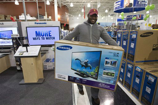 Jovel Cetoute, after waiting in line for several hours at the Pembroke Pines, Fla. Best Buy, Thursday, Nov. 22, 2012 got the tv he wanted.