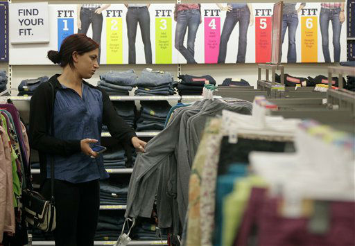 "<div class=""meta ""><span class=""caption-text "">Shopper Emily Roberts, from Hawaii uses her phone while looking for clothes sizes at the Target store in Burbank, Calif., on Thursday, Nov. 22, 2012.  (AP Photo/ Damian Dovarganes)</span></div>"