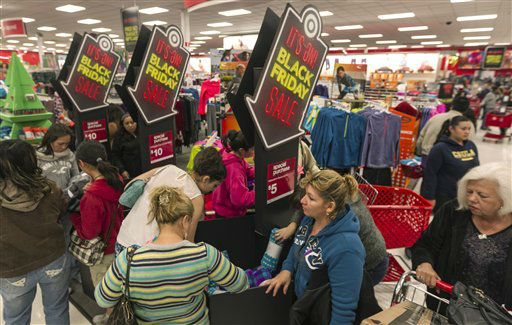 "<div class=""meta image-caption""><div class=""origin-logo origin-image ""><span></span></div><span class=""caption-text"">Shoppers get doorbuster deals at Target store in Burbank, Calif.,  on Thursday, Nov. 22, 2012. (AP Photo/ Damian Dovarganes)</span></div>"