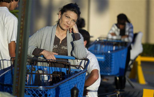 "<div class=""meta ""><span class=""caption-text "">Dora Hurtado waits in line at a Pembroke Pines, Fla. Toys-R-Us store, late Friday, Nov. 22, 2012.  (AP Photo/ J Pat Carter)</span></div>"