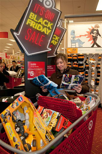 Target shopper Michelle Gianelli stocks up on doorbuster deals during the  Black Friday sale Thursday November. 22, 2012 at the Target store in Roseville, Minn.