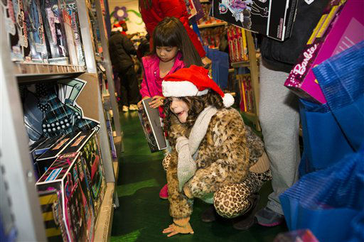 "<div class=""meta image-caption""><div class=""origin-logo origin-image ""><span></span></div><span class=""caption-text"">Savannah Finnerty, 7, of Queens, looks on shelves loaded with Monster High dolls at the Times Square Toys-R-Us store after doors were opened to the public at 8 p.m. on Thursday, Nov. 22, 2012, in New York.  (AP Photo/ John Minchillo)</span></div>"