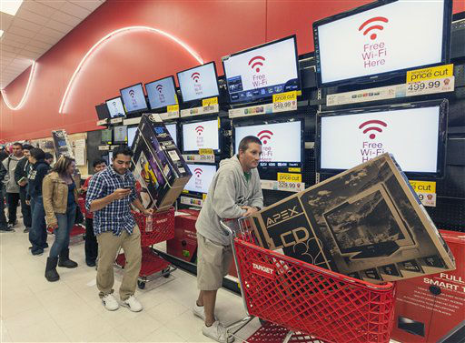 "<div class=""meta ""><span class=""caption-text "">Shoppers use their smart phone with the Free Wi-Fi service, while waiting in line to pay for electronics at the Target store in Burbank, Calif., on Thursday, Nov. 22, 2012.  (AP Photo/ Damian Dovarganes)</span></div>"