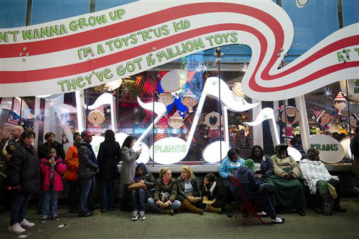 "<div class=""meta ""><span class=""caption-text "">Shoppers wait in line for the 8 p.m. opening of the Times Square Toys-R-Us store in the lead-up to Black Friday, November 22, 2012, in New York.  (AP Photo/ John Minchillo)</span></div>"