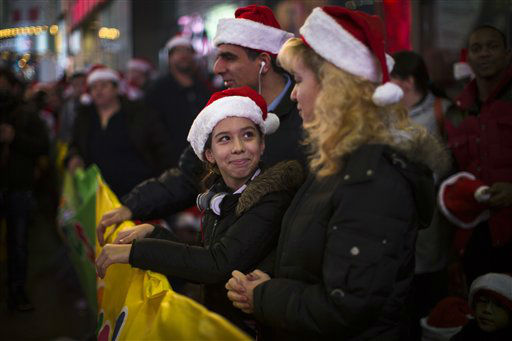 "<div class=""meta ""><span class=""caption-text "">Shoppers wait in line for the 8 p.m. opening of the Times Square Toys-R-Us store, Thursday, Nov. 22, 2012, in New York.  (AP Photo/ John Minchillo)</span></div>"