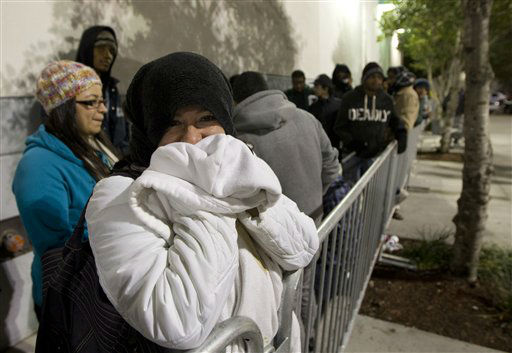 Nelly Vasquez and several thousand people wait in line at the Pembroke Pines, Fla. Best Buy, Thursday, Nov. 22, 2012 as they shop for bargains.  <span class=meta>(AP Photo&#47; J Pat Carter)</span>