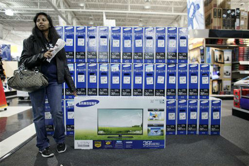 "<div class=""meta ""><span class=""caption-text "">A customer who declined to be identified waits by a television she was purchasing at a Best Buy store, Friday Nov 23, 2012, in Northeast Philadelphia.  (AP Photo/ Joseph Kaczmarek)</span></div>"