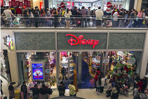 Consumers shop early morning hours Friday, Nov. 23, 2012 at the Disney store at  Glendale Galleria mall in Glendale, Calif.  <span class=meta>(AP Photo&#47; Damian Dovarganes)</span>