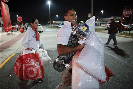"<div class=""meta ""><span class=""caption-text "">Rafael Pinguim, right, and Johanna Santos carry their purchases after shopping for Black Friday discounts at a Target store, Friday Nov 23, 2012, in Northeast Philadelphia.   (AP Photo/ Joseph Kaczmarek)</span></div>"
