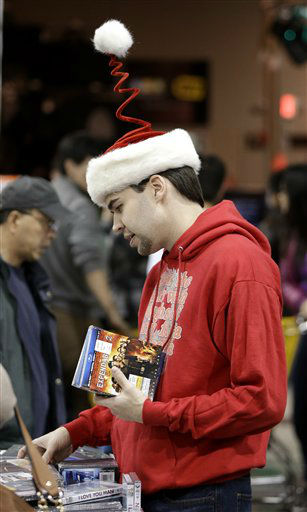 "<div class=""meta ""><span class=""caption-text "">Clint Fletcher shops for movies at a Best Buy store on Friday, Nov. 23, 2012, in Franklin, Tenn., after the store opened at midnight.   (AP Photo/ Mark Humphrey)</span></div>"