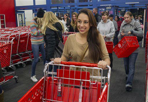 Shoppers rush to looking for doorbuster deals at the opening of the Target store in Burbank, Calif., on Thursday, Nov. 22, 2012.  <span class=meta>(AP Photo&#47; Damian Dovarganes)</span>