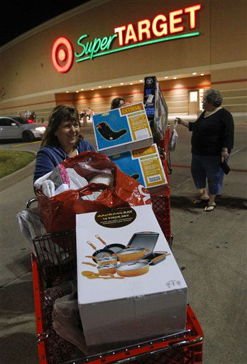 "<div class=""meta image-caption""><div class=""origin-logo origin-image ""><span></span></div><span class=""caption-text"">Machelle Maener leaves a Dallas area Target store at 10 p.m. with three cartfuls of Black Friday deals on Thursday, November 22, 2012 in Hurst, Texas.  (AP Photo/ Richard W. Rodriguez)</span></div>"