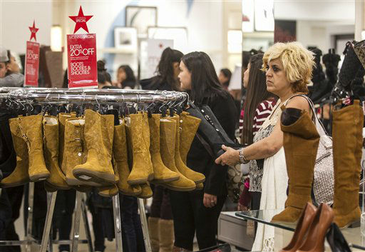Consumer Ilda Telamid, far right, shops for discounted boots in the early morning hours Friday, Nov. 23, 2012 at the Glendale Galleria mall Macy&#39;s store in Glendale, Calif.  <span class=meta>(AP Photo&#47; Damian Dovarganes)</span>
