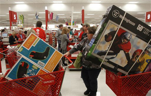 "<div class=""meta ""><span class=""caption-text "">Darlene Gober leaves a Dallas area Target store at 10 p.m. with two cartfuls of items after saving big on Black Friday deals on Thursday, November 22, 2012 in Hurst, Texas.  (AP Photo/ Richard W. Rodriguez)</span></div>"