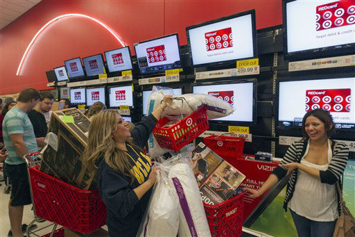 "<div class=""meta ""><span class=""caption-text "">Shopper Roxanna Garcia, middle, waits in line to pay for  her over a $1000.00 gifts at the Target store in Burbank, Calif., on Thursday, Nov. 22, 2012.  (AP Photo/ Damian Dovarganes)</span></div>"