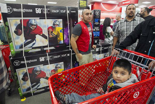 "<div class=""meta ""><span class=""caption-text "">Target team member Gabriel Corea, top left, guards the 50"" television doorbuster deal at the Target store in Burbank, Calif., on Thursday, Nov. 22, 2012.  (AP Photo/ Damian Dovarganes)</span></div>"
